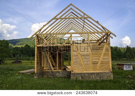 New Wooden House Under Construction In Quiet Rural Neighborhood. Timber Frame Of Natural Materials F