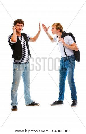 Young Man With Mobile Showing Wait Gesture His Indignant Friend