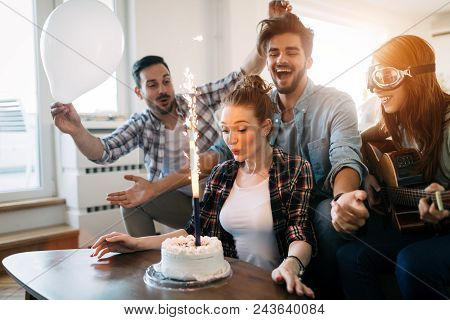Young Group Of Happy Friends Celebrating Birthday With Cake