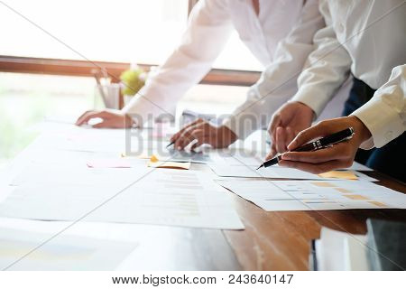 Business Consult Meeting On Wooden Table In Office.
