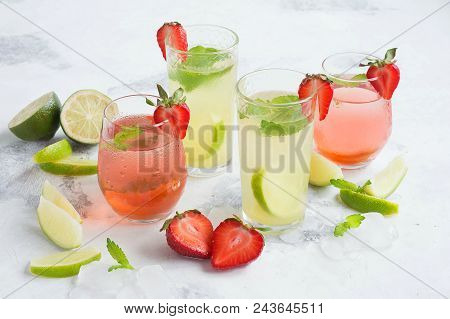 Cold, Non Alcoholic Cocktails. Iced Tea With Strawberries And Mint And Lemonade With Lime And Mint.