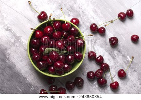 Fresh Cherries In Bowl On Table. Fresh Cherries In Pot On The Table.cherries. Sweet Cherries. Fresh