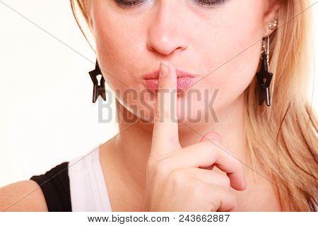 Gestures, Quiet Concept. Portrait Of Blonde Woman Making Silence Gesture, Half Face. Studio Shot, Is