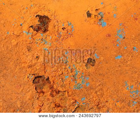 Grunge background with cracked rusty metal texture of orange and blue color