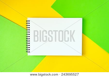 Minimal, Pop Art, Abstract, Vivid Mockup With White Notepad On Bright Green And Yellow Background.