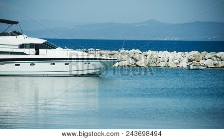Yacht Ship Anchored At Sea Pier. Yachting And Sailing. Luxury Travel On Boat. Summer Vacation And Wa