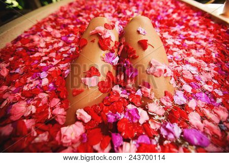 Woman In Bath With Petals. Time For Yourself. Self Love Concept.