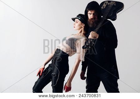 Stylish Hipster And Woman Together With Electric Guitar. Rock Couple Of Sexy Girl And Bearded Man Wi