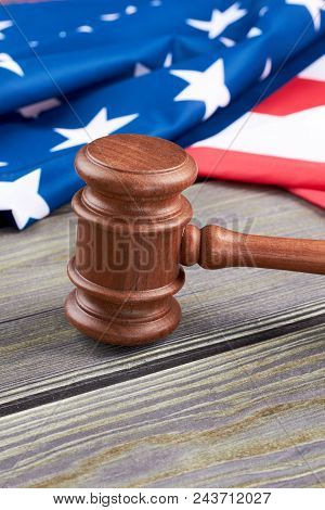 Judge Gavel On Table, Vertical Image. Justice Gavel With Usa Flag In The Background, Copy Space. Cou