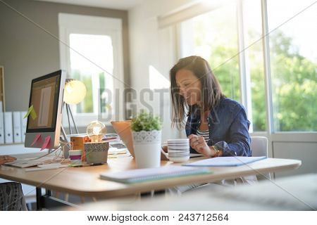 Cheerful girl working in co-working office