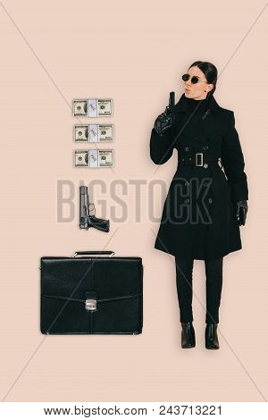 Top View Of Female Killer In Sunglasses With Briefcase, Handguns And Cash Isolated On Pink Backgroun