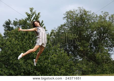 High Jump In Trees For Success Of Beautiful Girl