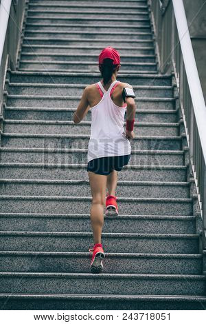 Young Woman Runner Sportswoman Climbing Up City Stairs Jogging And Running In Urban Training Workout