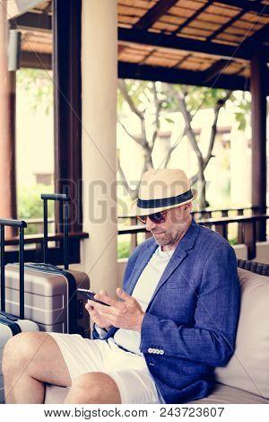 Dapper mature man at a resort