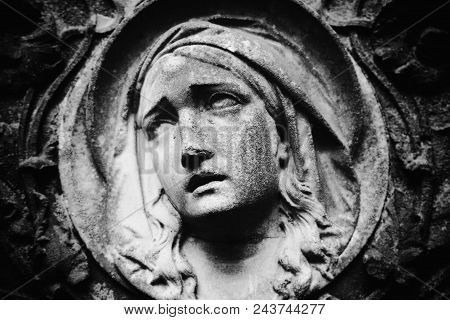 Virgin Mary Statue. Vintage Statue Of Sad Woman In Grief (religion, Faith, Suffering, Love Concept)