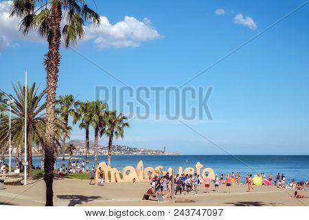 Malaga, Spain - June 02, 2018. Holidaymakers Sunbathing On Malagueta Beach, Malaga, Costa Del Sol, M