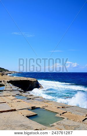Salt Pans Along The Waterfront With Views Out To Sea, Redoubt, Marsalforn, Gozo, Malta, Europe.
