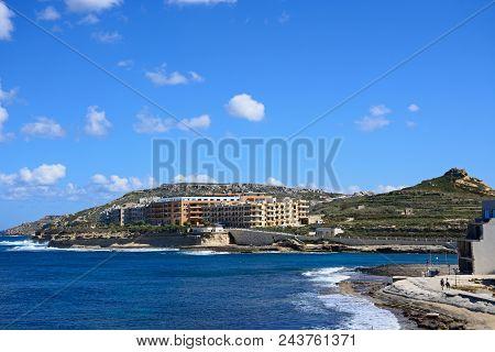Marsalforn, Gozo, Malta - April 3, 2017 - View Along The Rugged Coastline Towards Marsalforn With Ap