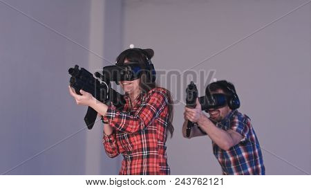 Friends Playing Vr Shooter Game With Virtual Reality Guns And