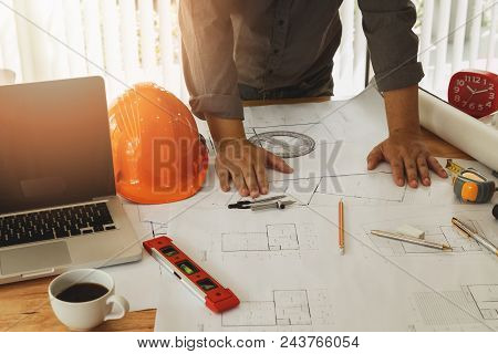 An Architect Or Engineer Working On Blueprint, Architectural Concept