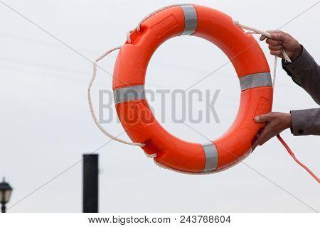 man holding life buoy