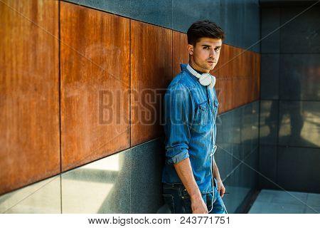 Modern Guy In Jeans Inside Minimalist Chamber