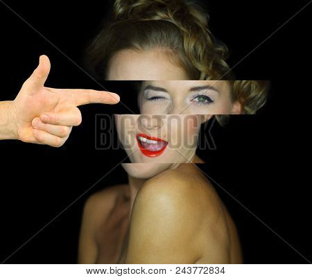 Collage with young woman with bare shoulders winks on dark background. Hand shifts girls eyes to side