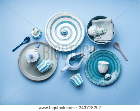 Blue pastel ceramic tableware crockery set on abstract background poster