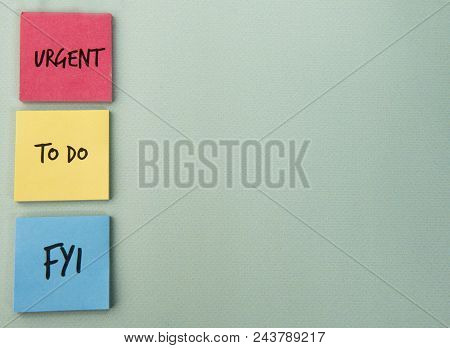 Urgent, to do and FYI written on note paper with copy space poster