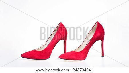 Shoes Made Out Of Red Suede On White Background, Isolated. Pair Of Fashionable High Heeled Pump Shoe