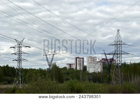 Landscape - Overgrown With Bush Terrain With Numerous Supports Of Transmission Lines Of Various Desi