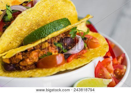Colorful Mexican Tacos In Shells On Gray Background