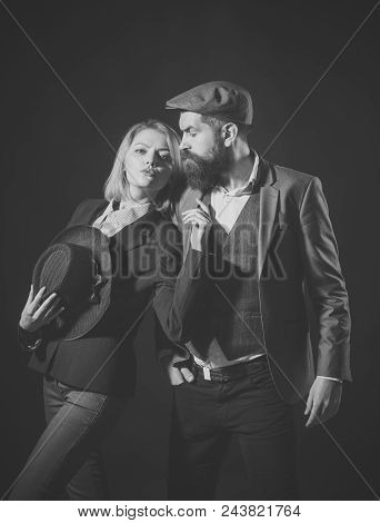 Couple Of Detectives Or Researchers, Private Investigators. Man And Woman In Retro Suit And Hat On D