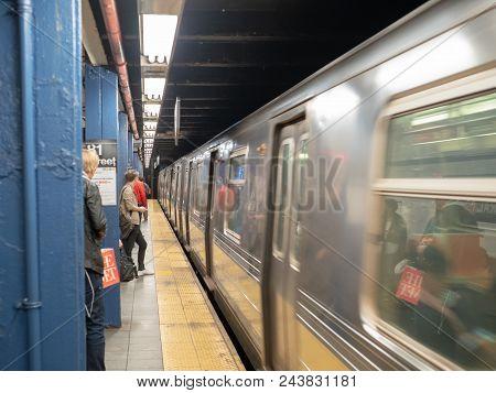 New York, Ny - May 18, 2018: Metropolitan Transportation Authority (mta) Subway Train Whizzing By Wa