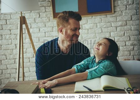 Red Haired Girl Does Not Want To Do Homework And Asks Father To Let Her Go. Laziness Concept. Father