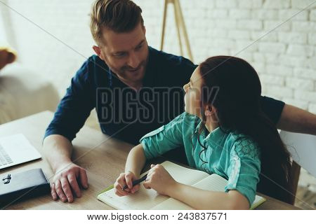 Teen Daughter Does Homework At Home With Single Father. Child Education Concept. Fatherhood.