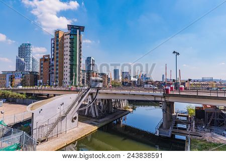 London, United Kingdom - April 20:  Buildings And River In The Docklands Area Near The Canary Wharf