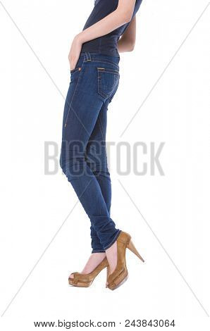 Side view woman legs in denim trousers high heels shoes