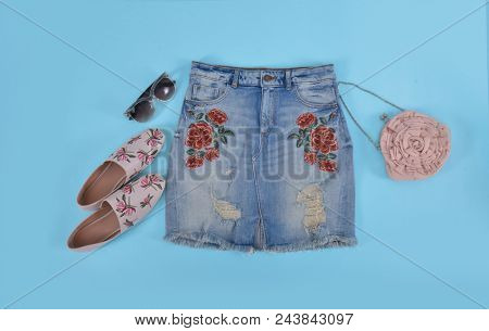 Embroidered flowers skirt jeans with shoes, handbag,sunglasses -blue background