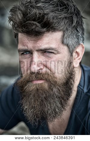 Man With Beard And Mustache, Close Up. Bearded Man On Serious Face Looks Sad And Troubled, Suffers F