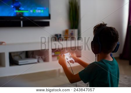 Back View Of Concentrated Young Gamer Playing Game. Gaming Game Play Tv Fun Gamer Gamepad Guy Contro