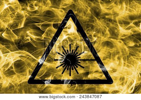 Laser Beam Hazard Warning Smoke Sign. Triangular Warning Hazard Sign, Smoke Background.