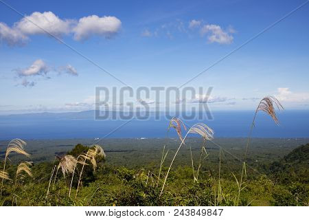 Sea And Distant Island Landscape Mountain View. Tropical Island Summer Travel Landscape. Green And B