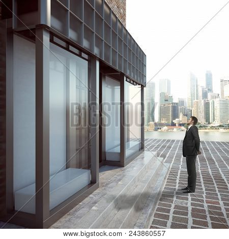 Side View Of Young Businessman Looking At Glass Storefront On City Background. Retail And Boutique C
