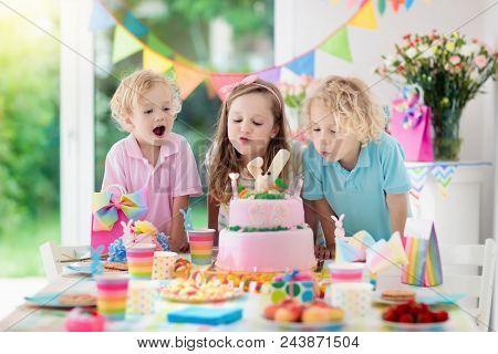 Kids Birthday Party. Children Blow Cake Candles.