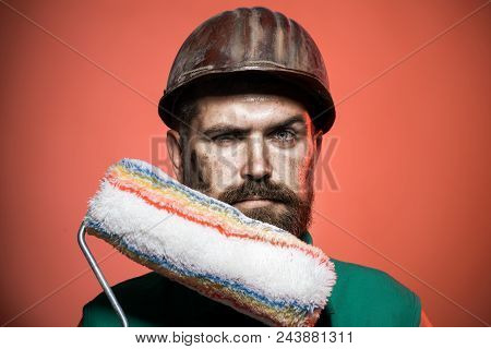 Painter Man. Male Decorator, Painter With Paint Roller. Interior Worker With Paint Roller In Room. R