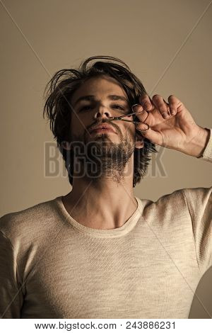 Men Health Care. Man Trimming Nose Hair With Scissors. Man With Disheveled Hair Grooming In Morning.