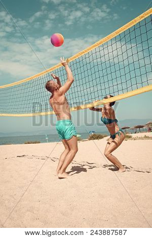 Beach Games. Beach Volleyball Concept. Couple Have Fun Playing Volleyball. Young Sporty Active Coupl