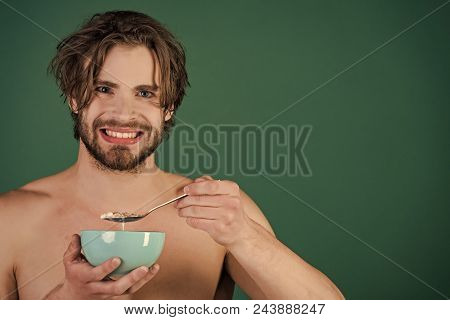 Healthy Eating. Dieting And Fitness, Calorie. Man With Wet Hair Eat Breakfast On Green Background. F