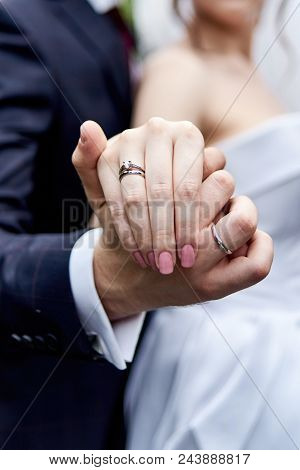 Wedding Rings, Copy Space. Newlywed Couple's Hands With Wedding Rings. Wedding Couple, Bride And Gro